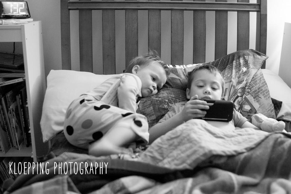 Siblings watching the phon