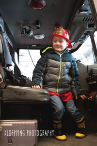 boy in the cab of the truck